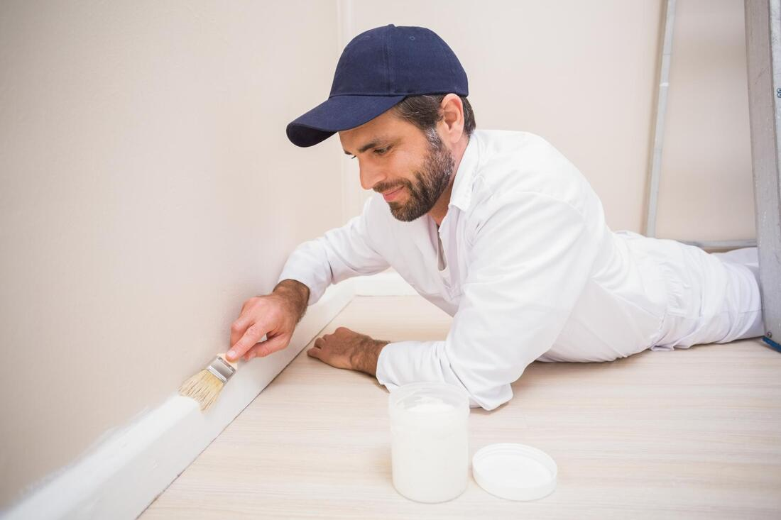 professional painter working on wall painting